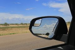 The Road in RearView Mirror royalty free stock photo