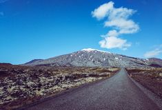 Road trip. Blue sky with one cloud. Infinity road stock photography