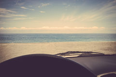 Road trip car sea ocean beach retro vintage Royalty Free Stock Photos