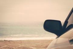 Road trip car sea ocean beach Stock Images