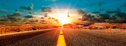 Road trip concept and sunset. Adventures and road trips.Sunset and travel concept.Road and fields Royalty Free Stock Photo