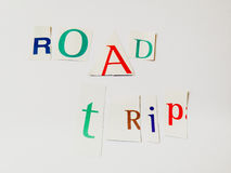 Road Trip - Cutout Words Collage Of Mixed Magazine Letters with White Background. Caption composed with letters torn from magazines with White Background Stock Images
