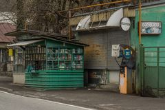 Old rotten kiosk and gas station royalty free stock images