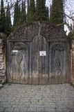 Wooden gate to bobde monastery stock photography