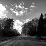 Road trip, grayscale, sky,. Road trip, grayscale royalty free stock image