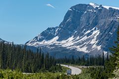 Road trip with a great view of big mountain and blue sky in Alberta, Canada.  stock images