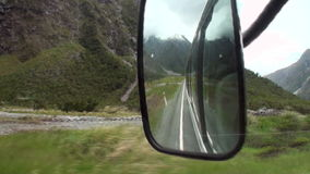 Road trip in the green mountains of New Zealand. stock video