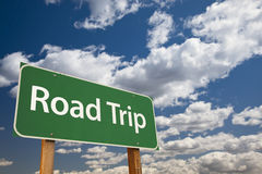 Road Trip Green Road Sign Over Sky Stock Photo