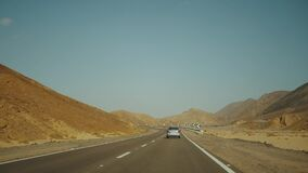 Road trip by highway in desert. Adventure travel in a desert slow motion.