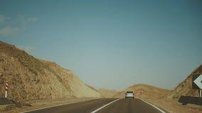 Road trip by highway in desert. Adventure Travel in a desert road in Egypt, 4k