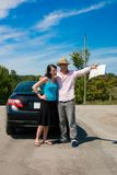 Road Trip - I know where we're. A young couple at a crossroad argue on which way to go Stock Photos