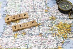 Road trip letters compass message Royalty Free Stock Images