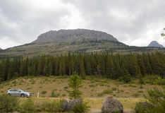 Road trip Mountain Landscape with Car in the foreground royalty free stock photography