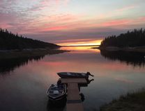 Boating and fishing at prelude lake. Watching the sunset by a calm Arctic lake Stock Photos