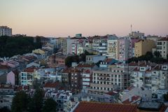 Sunset over residential area in lisbon royalty free stock photography