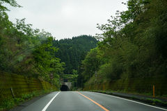 On road trip after raining through local green scenic route duri Stock Photo