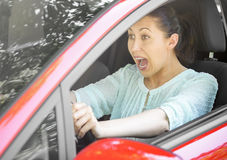 Road trip risk danger concept. Girl in the red car emergency brake. Road trip risk danger concept Royalty Free Stock Photos