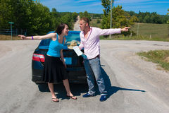 Road Trip - That's the right w. A young couple at a crossroad argue on which way to go Royalty Free Stock Photos