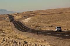 Road Trip. SUV on Desert Road - Colorado, USA royalty free stock photography