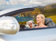 Woman recording voice on smartphone at car. Road trip, technology and communication concept - happy young woman using voice command recorder on smartphone riding royalty free stock photos
