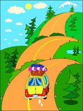 Road trip to the mountains. Road trip on vacation to the mountains on a hilly road. People travelling by car Royalty Free Stock Photo