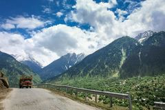 The scenic road to Sonamarg. Road trip to Sonamarg on a scenic road with snow capped mountains on either side. Kashmir, India Royalty Free Stock Photos