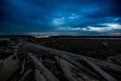Dark and Cold Keystone Beach on a Winter Sunset On Whidbey Island, Washington, United States. Road Trip to Whidbey Island and stop by Keystone Beach to take some Royalty Free Stock Images