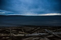 Dark and Cold Keystone Beach on a Winter Sunset On Whidbey Island, Washington, United States. Road Trip to Whidbey Island and stop by Keystone Beach to take some Stock Images