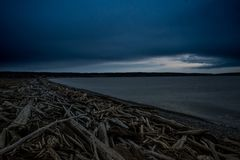 Dark and Cold Keystone Beach on a Winter Sunset On Whidbey Island, Washington, United States. Road Trip to Whidbey Island and stop by Keystone Beach to take some Stock Image