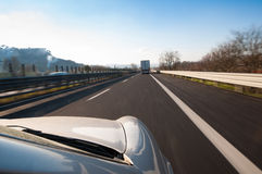 Road Trip. Travel by car on the highway at high speed Stock Photo