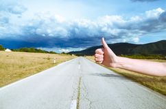 Road trip, travel, gesture and people concept - woman hitchhiking. And stopping car with thumbs up gesture at countryside Stock Photography
