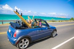 Hawaii road trip. Road trip travel - girls driving car in freedom. Happy young girls cheering in convertible car on summer Hawaii vacations stock photo