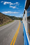 Road trip. Traveling far away by bus on a hot summer day Stock Image