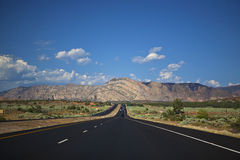 Road Trip in the Wide Open Spaces of America. Driving on a good road through the wide open spaces of the western United States stock photos