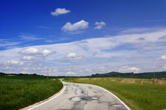 Road Trip. Road winding through gorgeous meadows Stock Images