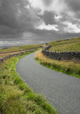 Road Trip in the Yorkshire Dales. Drystone walls line the winding single track country road to Malham in the Yorkshire Dales - the route of the Pennine Way Royalty Free Stock Photos