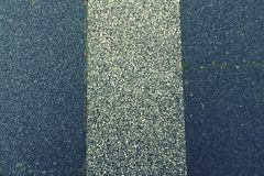Road tripping. Close up of a road with white stripe Stock Photo