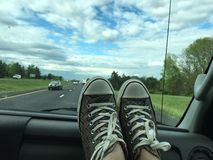 Road tripping. Feet on the dash during a long drive Stock Photo