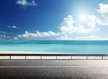 Road on tropical beach royalty free stock photography
