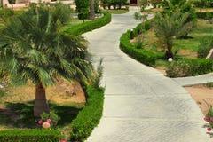 Road in tropical garden Stock Photo
