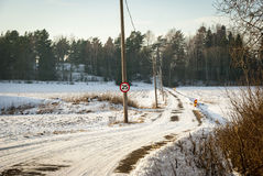 Road trough contryside in winter, Norway. Road trough norwegian contryside in snowy winter afternoon Royalty Free Stock Images