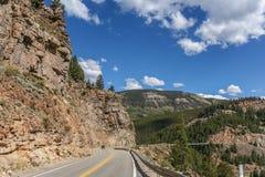 Road trough the Rocky Mountains in Colorado Stock Photos