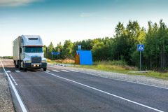 On the road. A truck carrying goods on the highway Stock Photos
