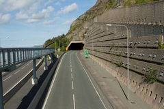Road tunnel. A tunnel on the A55 expressway, North Wales, UK, with a walkway and an engineered retaining wall with steel pins Stock Photography