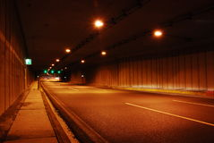 Road tunnel. Wide perspective in a long road tunnel Royalty Free Stock Photo