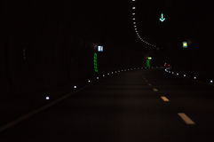 Road tunnel. Dark road tunnel with marking lights Stock Image