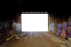 Road Tunnel with graffiti. Cluttered dirt road tunnel with graffiti and cutout exit Royalty Free Stock Images