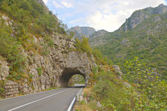 Road tunnel in  green Tara Canyon, Montenegro Stock Images