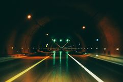 Road tunnel with light on, inside road runnel stock image