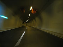 Road tunnel motion. Attractive colors in this shot of driving in a modern road tunnel Royalty Free Stock Photo